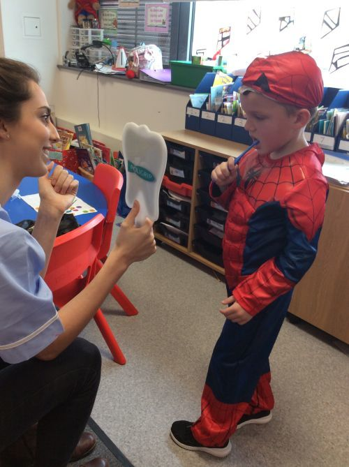 Spiderman cleaning his teeth